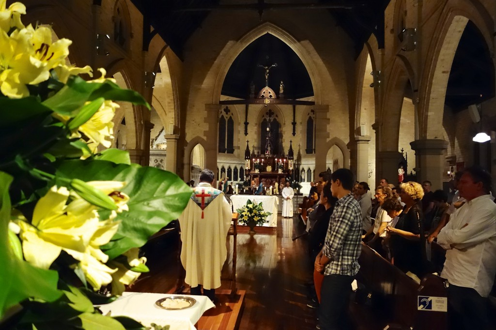 Uplifting Carols, beautiful Flowers and flickering Candles added to the atmosphere of the occasion at the well-attended Midnight Mass