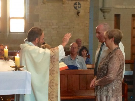 Father Chris Jenkins SJ blesses Harold and Jill Rich on the occasion of their 50th Wedding Anniversary at St Canice's in 1963.