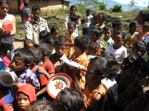 Children in one of the mountain communities gather quietly, waiting to receive their food