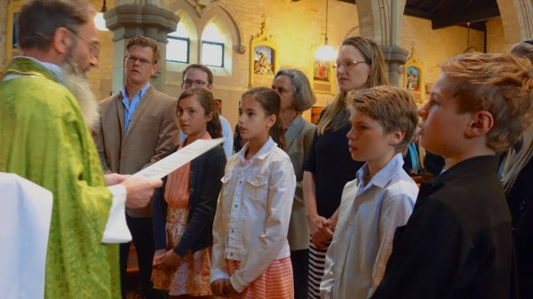 Father Chris Jenkins SJ and the five Confirmands, Pascal, Alex, Catherine, Charles and Nicolas