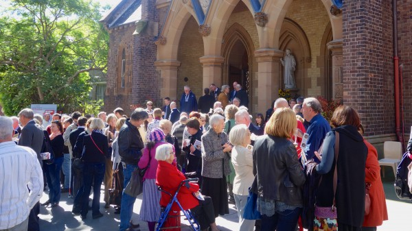 So many of the more than 300 parishioners and friends mingled in the forecourt of the church after the Mass