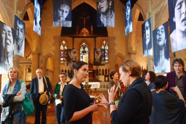 Colombian artist, Erika Diettes, seen here talking to St Canice's parishioner Margaret Spencer about her photographs of women who had been present at the torture and murder of their loved ones.