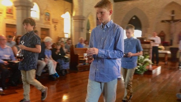 Patrick Jonathon and Aidan bring the gifts in the Offertory Procession