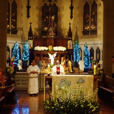 Father Chris Jenkins SJ celebrates all four Christmas Masses including this Midnight Mass