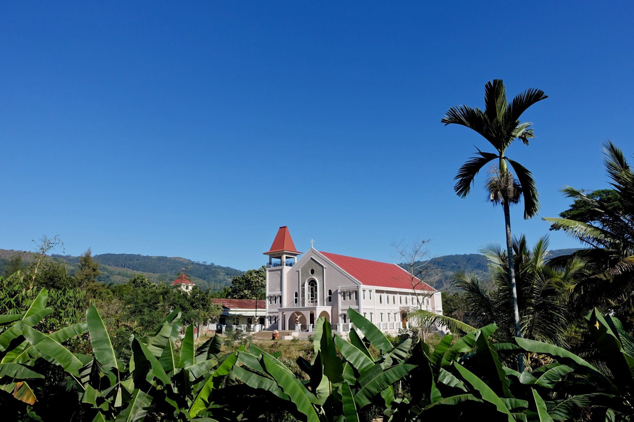 The new Railaco Parish church of Our Lady of Fatima is to be blessed and opened by the Bishop of Dili, His Lordship Bishop Virgilio do Carmo da Silva on October 7th this year to welcome the increasing numbers of people coming to Mass. The old church, seen in the background, will be used for much-needed parish Community activities.