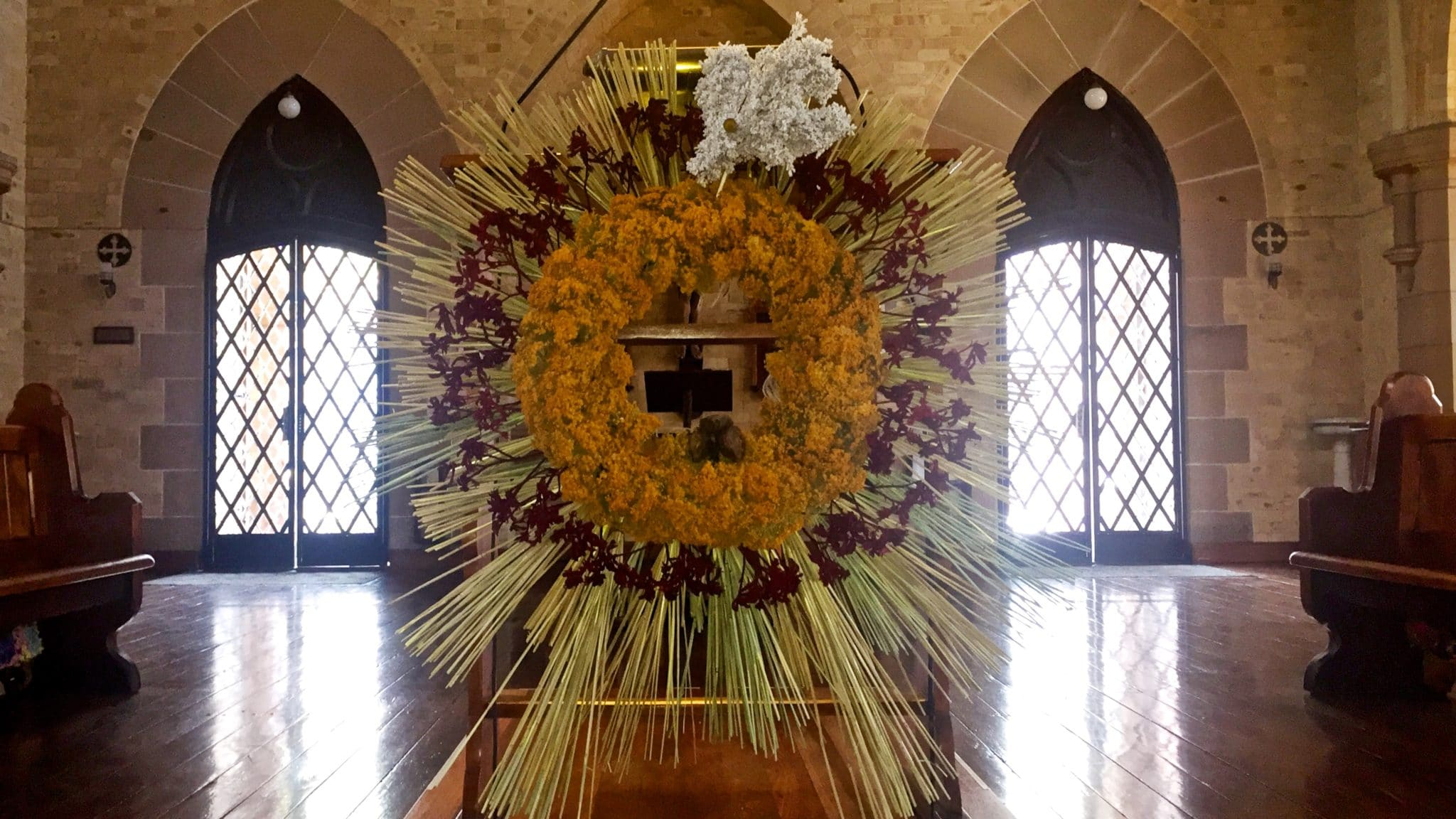 Long-time friend of St Canice's, Gerhard Haas has used WA wildflowers to craft a special tribute to the young people being confirmed today. The Holy Spirit in the shape of a dove has been made using white Smoke Bush, with yellow Morrison, red Kangaroo paw, with stalks of wheat as rays of the sun.